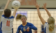 SUN PHOTO BY JENNIFER BRUNO          Charlotte's Emily Vaughn hits the ball through the hands of the Osceola defense during the quarter final game in Punta Gorda on Wednesday evening.