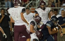 North Port's Devon Allen fights for a first down while being tackled by two Braden River defenders Friday night at North Port High School.