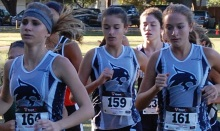 North Port cross country runners (from left to right) Shelby Cutchineal, Kaley Boethig, Lindsay Boethig and Darielle Costa run in the District 4A-8 championship meet at G.T. Bray Park in Bradenton on Saturday. Sun photo by Josh Vitale