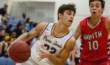 SUN PHOTO BY JENNIFER BRUNO          Charlotte's Trevor Bokon dribbles the ball down the court around North Fort Myers' Warren Leeds on Tuesday afternoon.