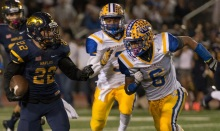 SUN PHOTO BY KATHERINE GODINA Charlotte's Jacob White gains on Naples'  Antonio Carbonaro during Friday's 6A Region 3 final. The Tarpons were handed their first loss of the season 35-0 by the Golden Eagles.