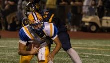 SUN PHOTO BY KATHERINE GODINA Charlotte's Brennan Simm's gets sacked by Naples' Wycleff Phanor during Friday's 6A Region 3 final 35-0 loss at Naples High