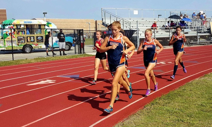 Lemon Bay's Kelsi Ogilvie, Abigayle Weinfeld and Kristen Robinson (from left to right) finish top three in the 3200 at Thursday's District 2A-11 championship at Booker High School in Sarasota. Sun photo by Josh Vitale
