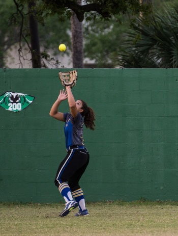 Charlotte's Kendall Chavarria catches a deep fly ball during Thursday's district championship at Fort Myers. Sun photo by Katherine Godina