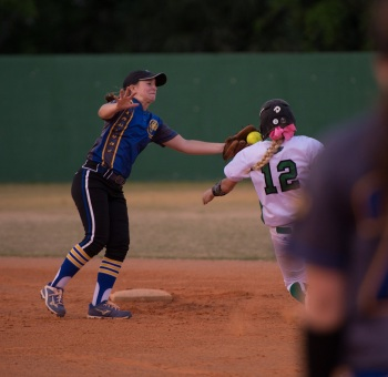 Charlotte's Marissa Stack tags out Fort Myers' Meghan Kline during the District 7A-11 title game on April 14. It marked the third time this season the Green Wave defeated the Tarpons. Sun photo by Katherine Godina