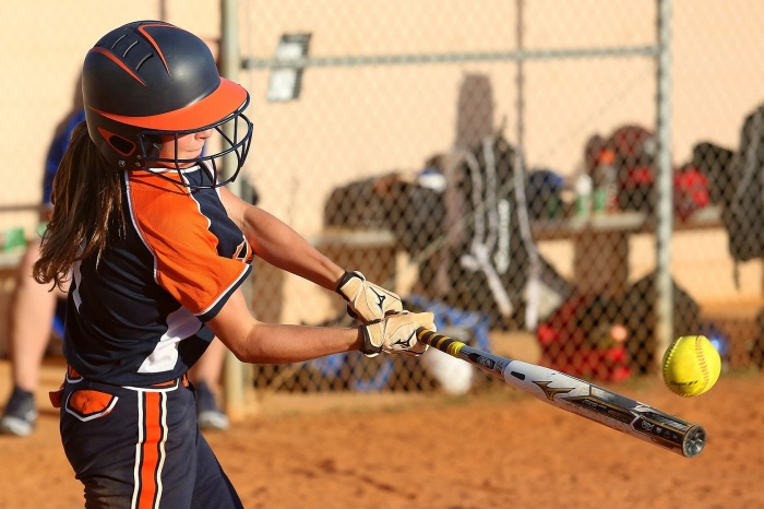 Lemon Bay's Leanna Kelly singles during Thursday's 15-0 rout of Imagine School. Sun photo by Tim Kern