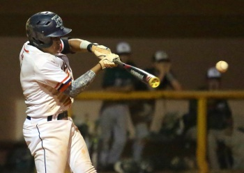 Lemon Bay's Warnner Rincones hits the game-winning three-run double in the sixth inning on Thursday. Sun photo by Tim Kern