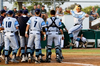 North Port's Patrick Smith celebrates with teammates after his two-run home run in the second inning. Sun photo by Justin Fennell