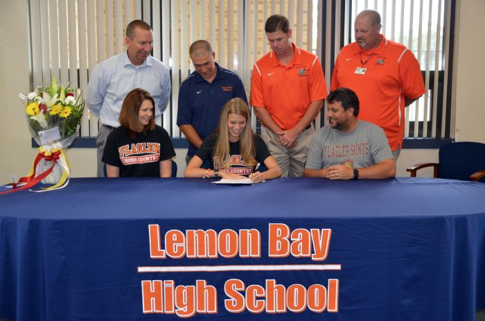 Abby Weinfeld signed with Flagler College Monday at Lemon Bay High School.