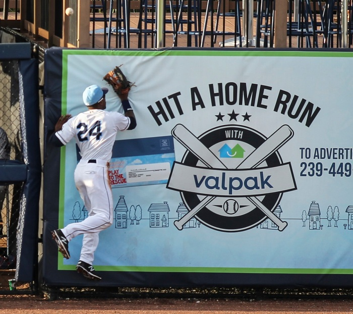 Charlotte Stone Crabs left fielder Bralin Jackson leaps up against the wall to make a play on a ball in the fifth inning Saturday. Sun photo by Tom O'Neill