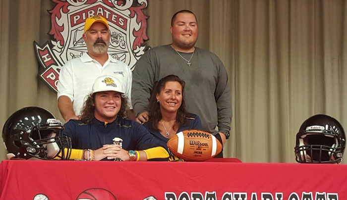 Port Charlotte football player Brennan Norus poses with family after signing with Warner University. Sun photo by Josh Vitale