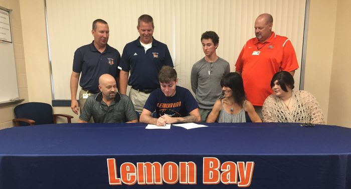 Lemon Bay's Jeremy Snook signed his letter of intent to play football at Webber International University on Thursday, Sun photo by Bryan Levine