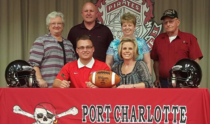 Port Charlotte football player Aaron Wertz poses with family after signing with Southeastern University. Sun photo by Josh Vitale