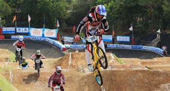 Amanda Carr goes airborne on a jump during the Thailand BMX Championships in March 2014. Photo provided by Thai Cycling Association