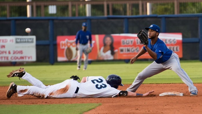 Stone Crabs third baseman Alec Sole dives toward second and tries to beat the tag from Dunedin's Richard Urena on Tuesday. Sun photo by Katherine Godina