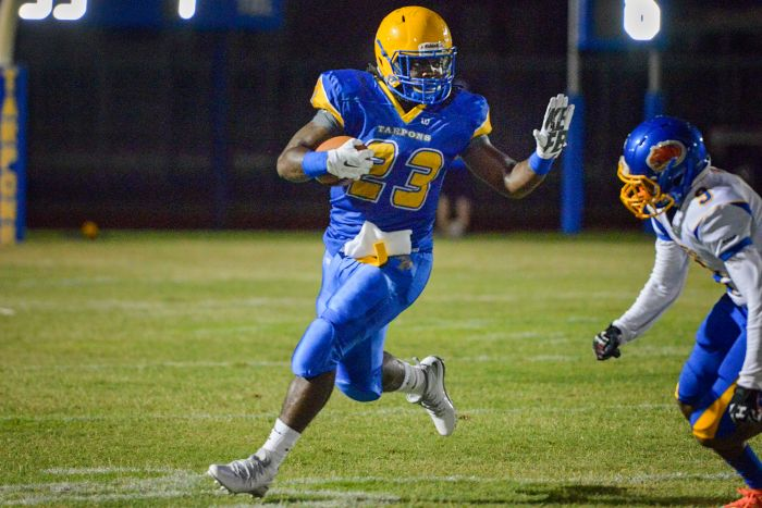 Charlotte's Maleek Williams holds of Clewiston during the preseason game held on the Tarpons home field (Sun photo by Jennifer Bruno).