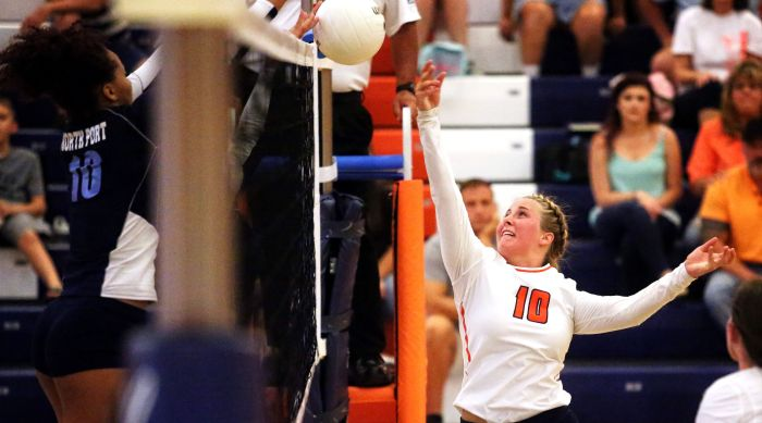 North Port's Alexis Francavilla blocks a shot as Lemon Bay's Breanna Nelson attempts to recover. (Sun Photo by Tim Kern).