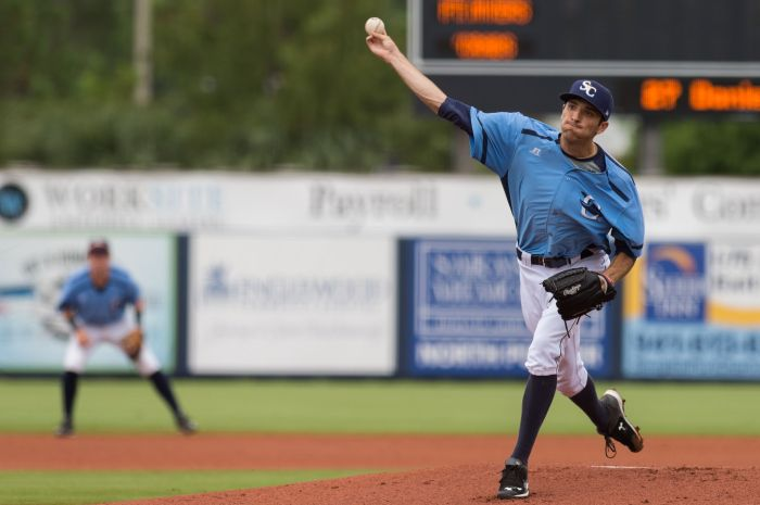 Charlotte's Greg Harris delivers a pitch against Fort Myers on Sunday afternoon at Charlotte Sports Park.