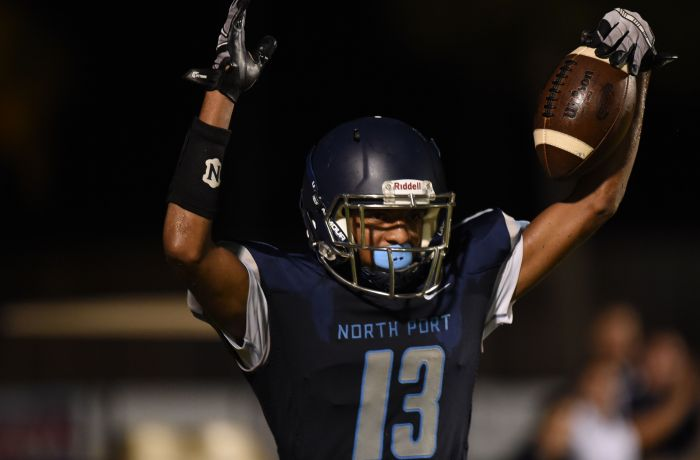 Norther Port WR C. K. Poulos raises his hands after scoring a touchdown for the Bobcats. (Sun Photo by John Kersten).