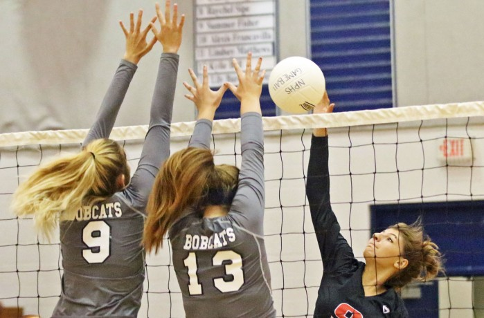 Port Charlotte's Samantha DiBene is blocked by North Port's Summer Fisher (9) and Abby Hutchinson during Wednesday night's match at North Port (Sun Photo by Michele Haskell)