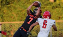 Lemon Bay wide receiver Victor Mellor (7) catches a touchdown pass against Cardinal Mooney  during the first quarter Friday at Lemon Bay High School (Sun photo by Tom O'Neill).