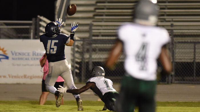 North Port's Andrew Bosma catches a pass for a touchdown against Palmetto Ridge's Jerome Cunningham on Friday night in North Port. (Sun Photo By John Kersten)