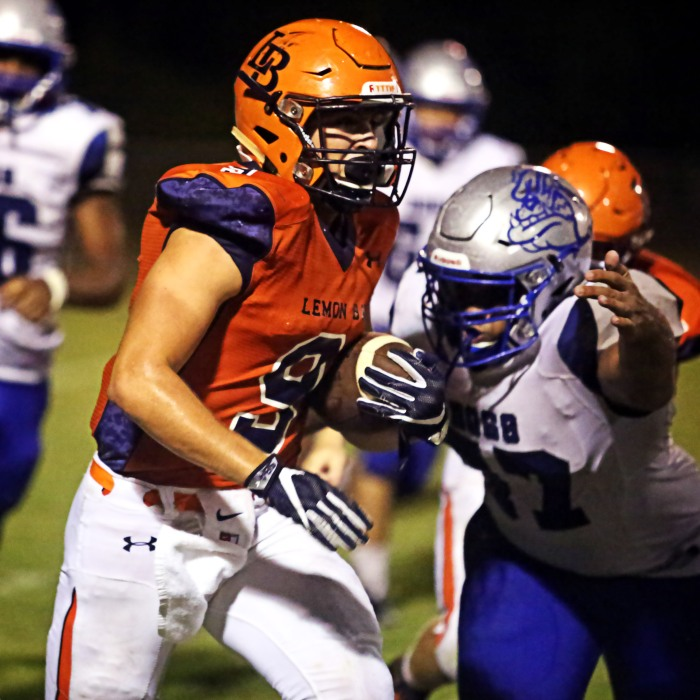 Brayden Curry provides a second half spark for the Lemon Bay Manta Rays as he breaks off two long runs before punching in a one yard touchdown. (Sun photo by Tim Kern).
