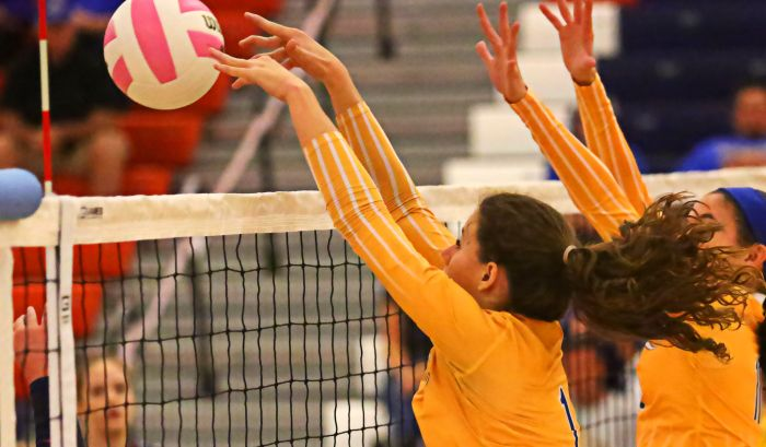 Shelby Beisner blocks the ball at the net to win the Charlotte Tarpons a point against Lemon Bay. The Tarpons dominated the Manta Rays in 3 straight sets overwhelming them at the net.