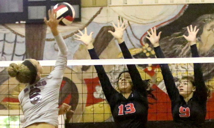 Riverview's Alex Hilton goes for a point as Port Charlotte's Nicole Nava, left, and Samantha DiBene block during Monday nights game (Sun photo by Michele Haskell)