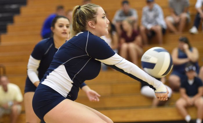 North Port's Raychel Sipe returns a serve against Lemon Bay on Thursday night in North Port (Sun photo by John Kersten).
