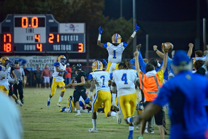 The Charlotte Tarpons celebrate their win over the Port Charlotte Pirates with a score 21-17 on Friday evening (Sun Photo by Jennifer Bruno).
