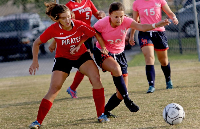 Port Charlotte's Alden Goucher ,left, and Lemon Bay's Alexandra Gassman battle for control during Tuesday night's game at Charlotte High School (Sun Photo by Michele Haskell).