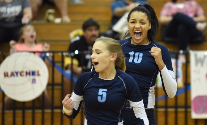 North Port's Sydney Hoggarth (5) and Alexis Francavilla (10) celebrate a point against DeSoto on Thursday night in North Port (Sun Photo by John Kersten).