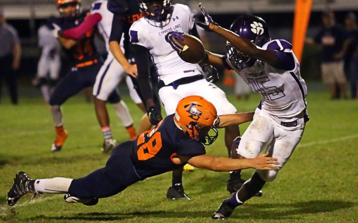 Logan Lydic makes a great open field tackle to help his Manta Rays. (Sun Photo by Tim Kern)