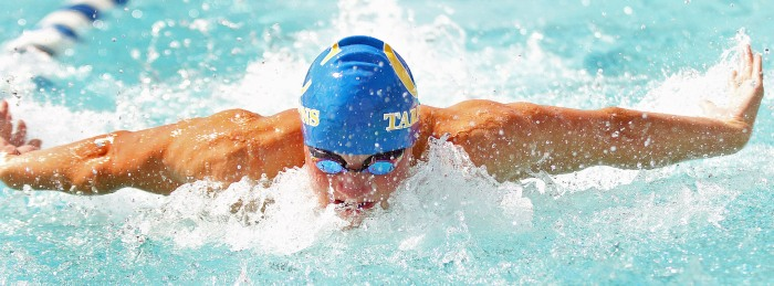 Charlotte's Alexander Rand competes during the Boys 100 Yard Butterfly,during Thursday's meet in Punta Gorda (Sun Photo by Michele Haskell)