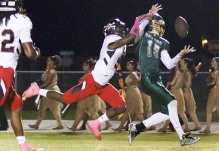 Port Charlotte's William Furlow blocks a pass to Island Coast's Bobby Martin inside the end zone during Friday night's game in Cape Coral (Sun Photo by Michele Haskell).