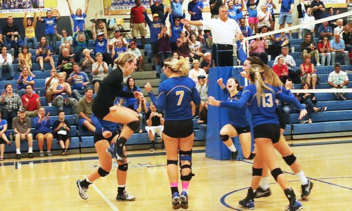 Charlotte girls celebrate their sweep victory against North Ft. Myers for the district championship, Thursday night (Sun Photo by Michele Haskell)