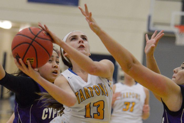 Charlotte's Kelyn Moses goes up for a shot against Cypress Lake on Wednesday (Sun Photo by Jennifer Bruno).