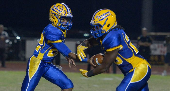 Charlotte Quarterback, Dee Hicks, hands off the ball to Maleek Williams during the playoff game against Clearwater (Sun photo by Jennifer Bruno).