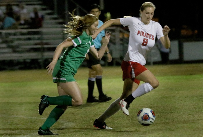 Port Charlotte's Asia Mazieko takes the ball up the field as Ft. Myers Kayla Thorne moves to defend,during Thursday night's game at Port Charlotte (Sun Photo by Michele Haskell)