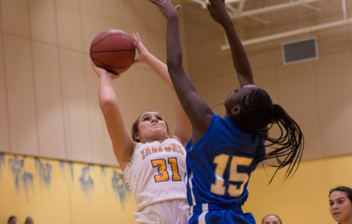Charlotte's Michelle Bunch drives to the basket against G. Holmes Braddock's Kalia McIntyre during Tuesday's game at Island Coast (Sun Photo by Kat Godina).