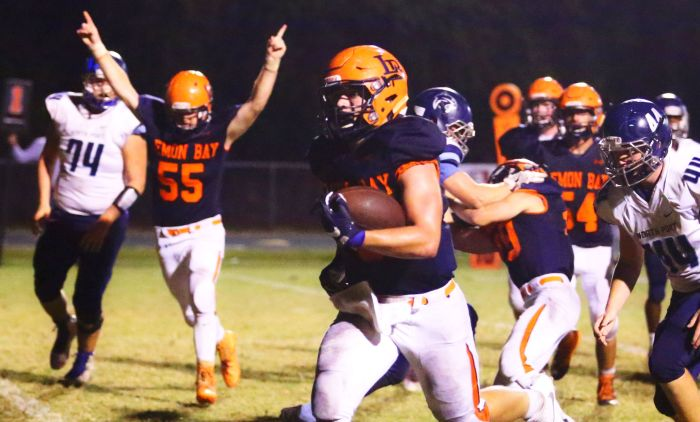 Brayden Curry scores another rushing touchdown for the Lemon Bay Manta Rays (Sun photo by Tim Kern).