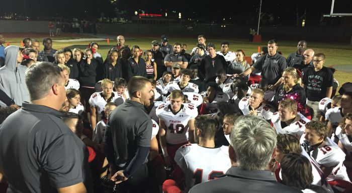 Port Charlotte coach Jordan Ingman addresses his team following a season-ending 24-16 loss against Clearwater Friday night (Sun photo by Bryan Levine)