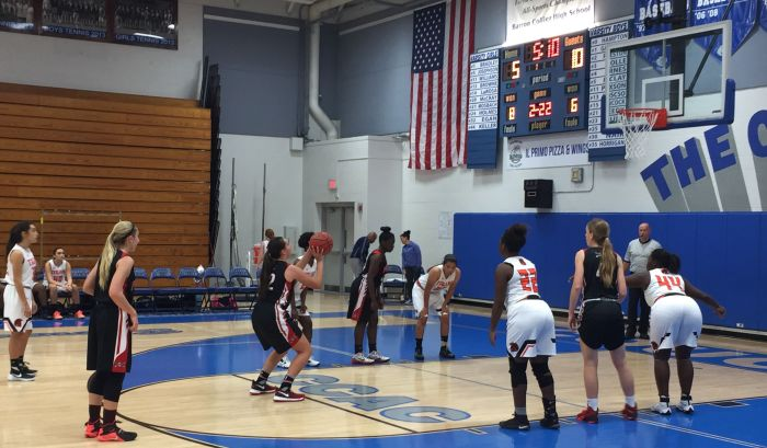 Port Charlotte High School's Celia Baermann lines up to attempt a free throw Wednesday (Sun Photo by Bryan Levine).