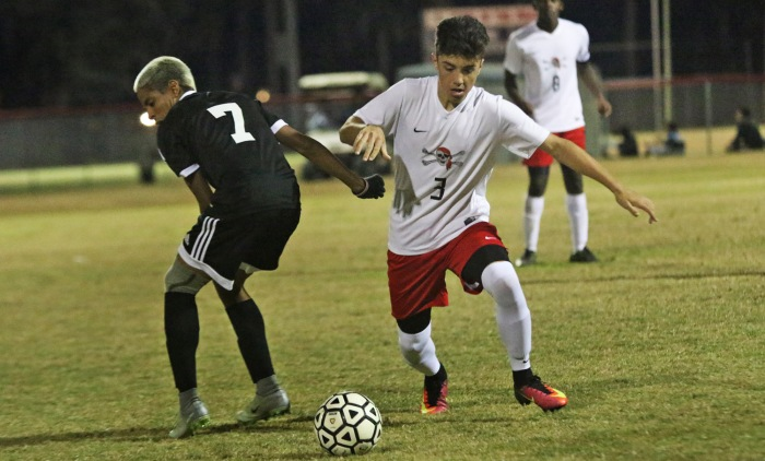 Port Charlotte's Nate Ruth breaks away from Cape Coral's Joseph Nizama during the 1st half of Monday's night's game at Port Charlotte (Sun photo by Michele Haskell).