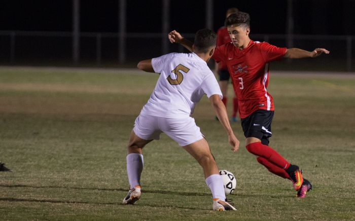 Port Charlotte's Nathan Ruth looks to get around Island Coast's Crystian Franco during Tuesday's game (Sun photo by Kat Godina).