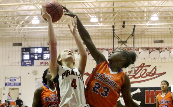 Port Charlotte's Rachael Livingston goes up for two as Cape Coral's Joilynn Lewis blocks in the 4th quarter of Tuesday night's game at Port Charlotte (Sun photo by Michele Haskell).