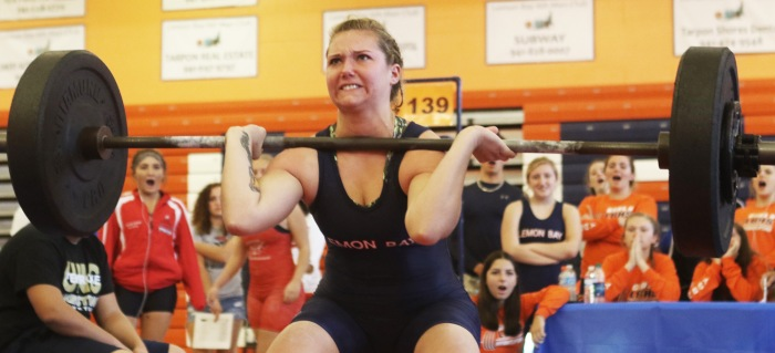Lemon Bay's Savanna Galloway works to complete a 140-pound clean and jerk as her teammates react during Saturday's match (Sun Photo by Michele Haskell).