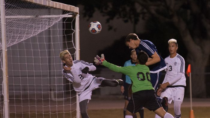 North Port's Jeremiah Simonthcik headers the ball to the goal as Mariner's Anthony Rodriguez (00) and Jason Arias (12) try to prevent the goal during Tuesday's game at Mariner (Sun Photo by Kat Godina).