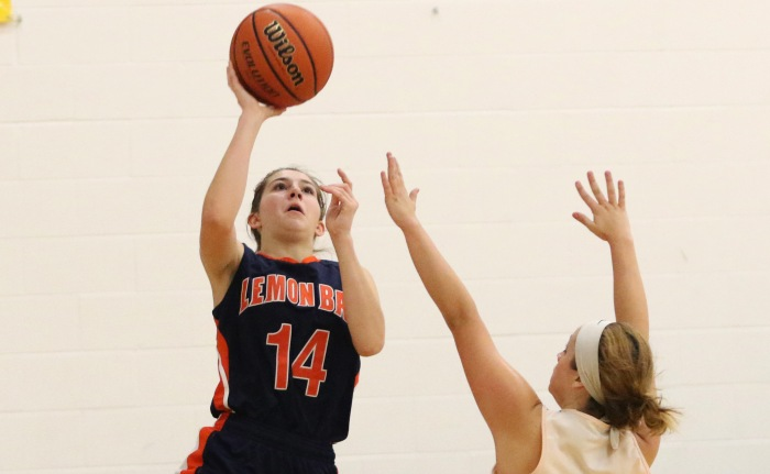 Lemon Bay's Katie Stevens takes a shot as Imagine's Marlena Marra attempts to block it during Tuesday night's game in North Port (Sun Photo by Michele Haskell).